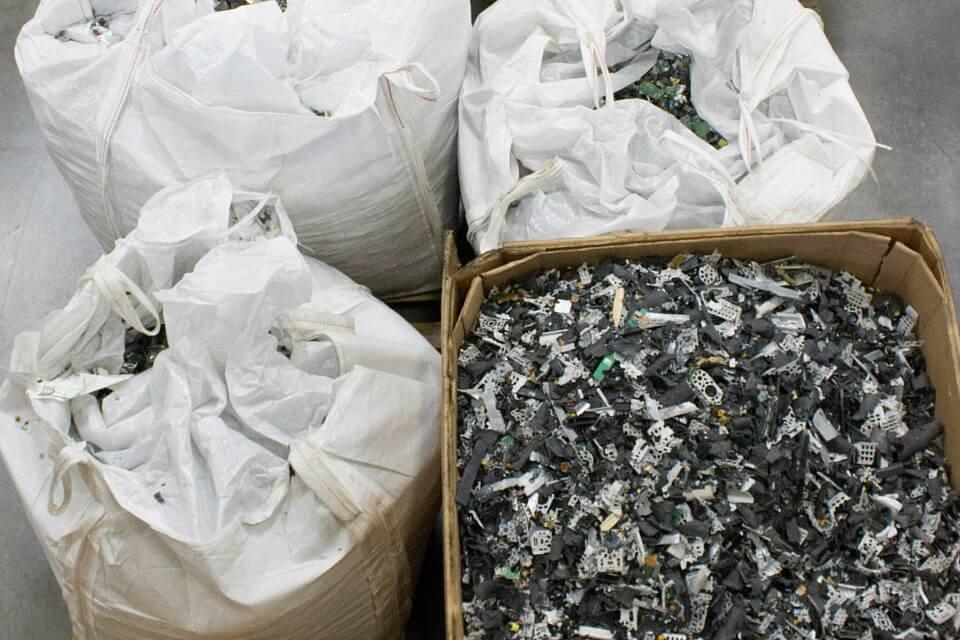 Shredded material prepared for shipment to downstream vendor